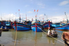Local fishing boats are mooring in the Tuy Hoa seaport Stock Image