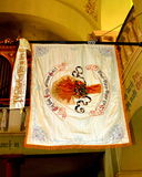 Local flag in the church of fortified medieval church Cristian, Transylvania stock images