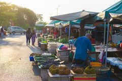 Local food market in Miri, Borneo, Malaysia. Miri, Malaysia - August 3, 2014: People roaming in local fruit and vegetable market at sunset in Miri, Borneo stock photos