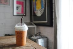Local food Thai iced tea. On wooden table royalty free stock photography