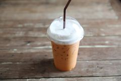 Local food Thai iced tea. On wooden table stock images