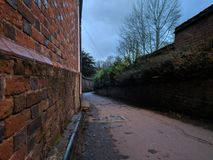 Footpath at dusk. A local footpath in Southern England, dimly lit with the remains of the day`s sun Royalty Free Stock Photos
