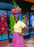 Local fruits trader is greeting buyers on a market place. Jamaica Royalty Free Stock Images