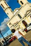 Local girl looking at Cienfuegos Jose Marti central park cathedral. Cienfuegos Province, Cuba royalty free stock photos
