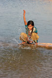 Local girl playing near water reservoir, Khichan village, India Stock Photography