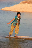 Local girl playing near water reservoir, Khichan village, India Stock Images
