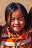 Local girl in a small community near Muang Sing, Laos. Local girl in a small ethnic community near the village of Muang Sing in Laos Royalty Free Stock Photography