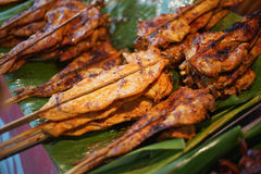 Local grilled chicken on green leaf in thailand Stock Photos