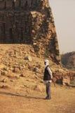 Local guard walking around Tughlaqabad Fort, New Delhi Stock Photography