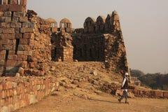 Local guard walking around Tughlaqabad Fort, New Delhi Stock Image