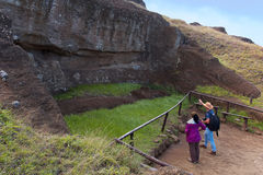 Local guide educates a visitor on the unfinished Moai Statues royalty free stock photo