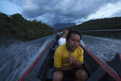 Local guide sitting in a boat Canaima National Park Royalty Free Stock Photography