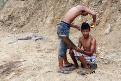 Local Haircut Outdoors in Chin State, Myanmar Royalty Free Stock Images
