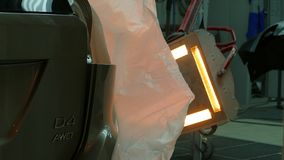 Local heater lamp for paint drying stock video