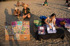 Local hippies sell hand-made goods at a flea market in Arambol. 19 January 2017. local hippies sell hand-made goods at a flea market in Gokarna on the beach at Royalty Free Stock Photo