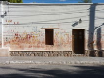 Local house in the north of Argentina. Kids handpainting in the walls of a local house in the north of Argentina Royalty Free Stock Image