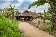 Traditional hut where the Long Neck Karen tribe lives in Chiang Rai, northern Thailand. Local houses at Long Neck Karen ethnic hill-tribe guarded village, Chiang royalty free stock images