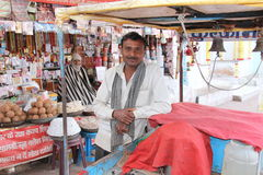 A local ice cream vendor with his push cart. At Chitrkoot, MP, India. Another vendor with his shop of religious stuff is visible in the background Royalty Free Stock Images