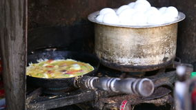 Local Indian food being prepared on stove at street stand in Jodhpur. stock footage