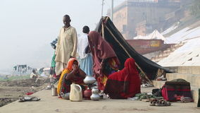 Local Indian people at ghats of the Ganges river in India. VARANASI, INDIA - 25 FEBRUARY 2015: Local Indian people at ghats of the Ganges river in India stock footage