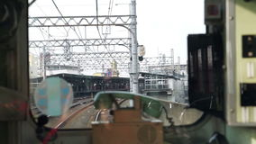 Local Japanese train with classic phone and window frame foreground stock video