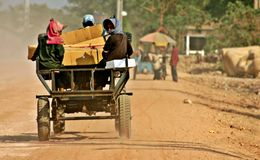 Departure. Local Khmer taxi taking passengers along dirt road. Western Cambodia Royalty Free Stock Photos