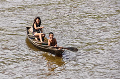 Local kids in a boat on the Amazon River, Brazil Stock Photography