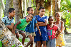 Local kids standing by palm trees in Lavena village, Taveuni Isl Royalty Free Stock Image