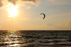 Local kitesurfer get the last kite in for the day Royalty Free Stock Photography