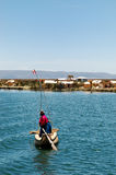 A local on Lake Titicaca. Local from a Uros island on Lake Titicaca stock photography