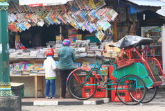 Indonesia street book shop. People buying magazines at Magazine shop in Malioboro street Jogyakarta Java Indonesia Stock Images