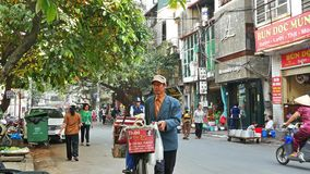 Local daily life of the street in Hanoi Old Quarter and people can seen exploring around it. Hanoi,Vietnam - December 18, 2017 : Local daily life of the street stock video footage