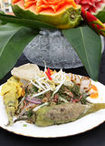Local Malay Dish. A plate of a local Malay dish comprising fried fish, stuffed green chili, bean sprouts, fish cake, Malay salad or kerabu, salted egg royalty free stock photo