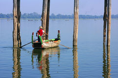 Local man in a boat near U Bein Bridge, Amarapura, Myanmar Royalty Free Stock Image