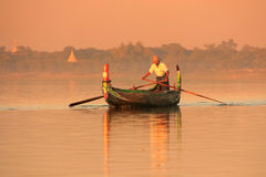 Local man in a boat at sunset, Amarapura, Myanmar. Local man in a boat at sunset, Amarapura, Mandalay region, Myanmar royalty free stock image