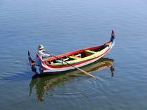 Local man in a boat at sunset, Amarapura, Myanmar Royalty Free Stock Image