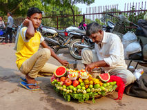 Local man with a boy selling fruit outside Jama Masjid in Fatehp Royalty Free Stock Image