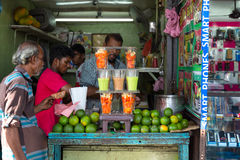 Local man buying fruit juice from street vendor Stock Photography