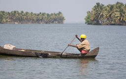 Local man in canoe. Canals are local special feature of Kochi (Cochin), Kerala, India Royalty Free Stock Images