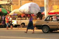 Local man carrying big bag with goods on his head, Yangon, Myanm Stock Image