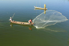 Local man fishing with a net from a boat, Amarapura, Myanmar Stock Photography