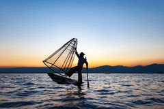 Local man fishing with a net at sunset, Amarapura, Mandalay region, Myanmar. Local man fishing with a net at sunset, Amarapura, Mandalay region, Myanmar royalty free stock photos
