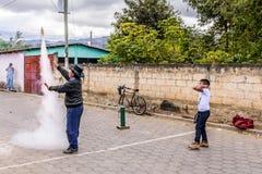 Local man ignites rocket in street, Guatemala Royalty Free Stock Image