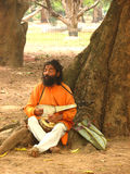Local man in India. Local inhabitant of West Bengal in India, playing traditional instrument Royalty Free Stock Photo