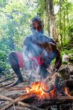 Local man of the island New Guinea have dinner the caught possum cuscus. Royalty Free Stock Photo