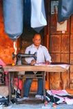 Local man making motorbike seat covers at Johari Bazaar street i Stock Photography
