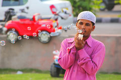 Local man making soap bubbles at Man Sagar Lake waterfront in Ja Stock Photos