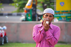 Local man making soap bubbles at Man Sagar Lake waterfront in Ja Royalty Free Stock Images