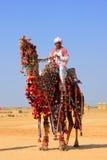 Local man riding a camel at Desert Festival, Jaisalmer, India Stock Photo