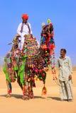Local man riding a camel at Desert Festival, Jaisalmer, India Stock Photography